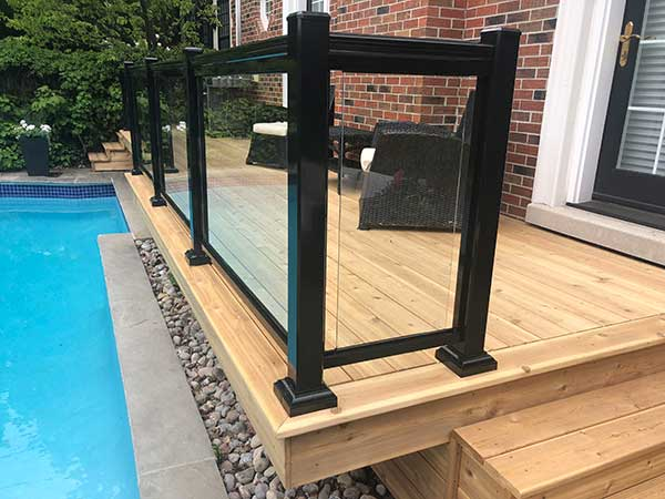 cedar deck by pool by green side up contracting